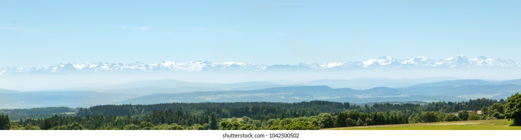 The Alps faraway, german Black forest in the front, Panorama with copyspace