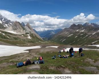 Alps, France, Tour du Mont Blanc - tourists on the Col de la Seigne