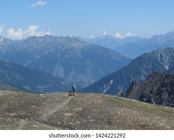 Alps, Italy - around the Col de Malatra pass, view with the lonely tourist