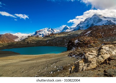 Alps mountain landscape and mountain lake in a beautiful day in Switzerland