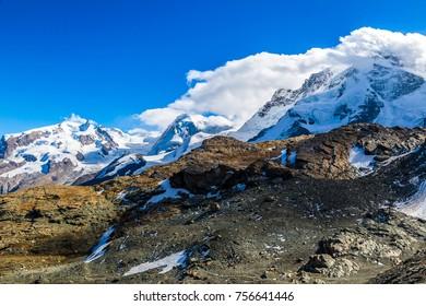 Alps mountain landscape next to Zermatt  in a beautiful summer day in Switzerland