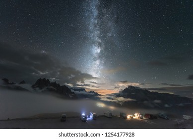 Alps Mountain landscape with night sky and Mliky way, Tre Cime di Lavaredo, Dolomites.