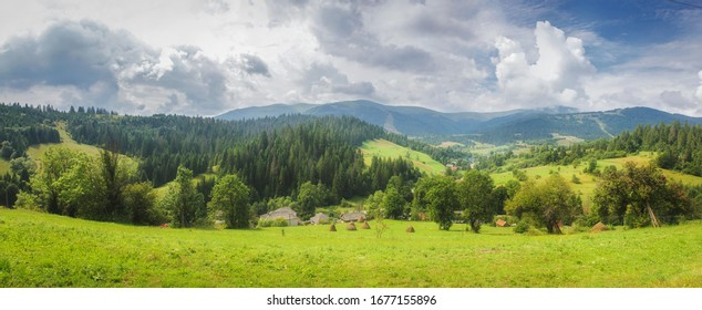 Alps mountain meadow tranquil summer view.  Mountain valley village landscape summer. Mountain village view. Village in mountains. Mountain valley village landscape.