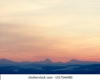alps mountains in evening leight