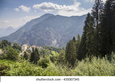 Alps mountains with green forests in sunlight. Asiago Plateau, Italy