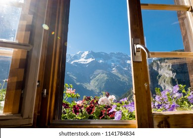 Alps in summer morning. Gimmelwald, Lauterbrunnen, Switzerland, Alps mountain landscape through the window. Europe Swiss.