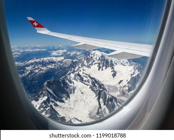ALPS, SWITZERLAND - JUNE 23, 2018: Flying over the Alps with Swiss Air.