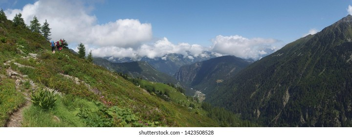 Alps, Switzerland, Tour du Mont Blanc - on the route from the Col de la Forclaz pass to the Col de Balme, view with hiking tourists