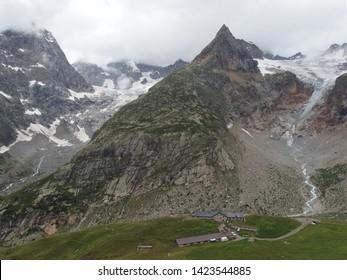 Alps, Switzerland, Tour du Mont Blanc - Grand Col Ferret pass, view with peak Tete de Ferret and refuge
