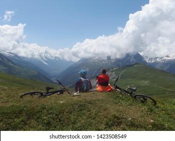 Alps, Tour du Mont Blanc - cyclists on the Col de Balme pass on the Franco-Swiss border
