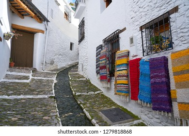 Alpujarras street rugs in Pampaneira of Granada colorful serape