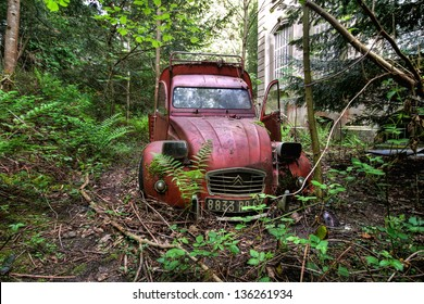 ALSACE - FEB. 05: A demolished Citroen 2CV van was abandoned in woods, February, 05, 2012, France.