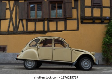 Alsace, France - 08 23 2018: The wine route in Alsace, France. Citroën 2CV in Dambach-La-Ville