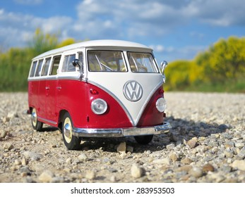 ALSACE, FRANCE - MAY 29, 2015:Miniature VW Bulli 1962 on the rural road. The cult car of the Hippie generation and it remained the status vehicle of the high wave surfers.