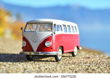 ALSACE, FRANCE - NOVEMBER 7, 2015:Miniature VW Bulli 1962 on the rural road. The cult car of the Hippie generation and it remained the status vehicle of the high wave surfers.