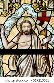 ALSEMBERG, BELGIUM - APRIL 3, 2008: Stained Glass window depicting the Resurrection of Jesus in the Church of Alsemberg, Belgium.