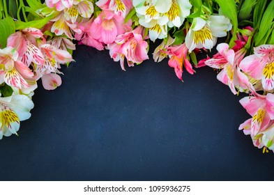 Alstroemeria flowers background. Alstroemeria. Flowers Alstroemeria. Bouquet of alstroemeria flowers on black wooded background