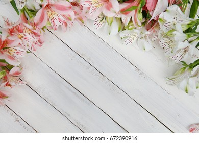 Alstroemeria flowers background. Alstroemeria. Flowers Alstroemeria. Bouquet of alstroemeria flowers on white wooded background