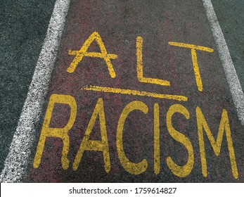 ALT RACISM written painted on a bicycle lane with yellow paint in perspective view. conceptual image for current world battles for equal rights for people of all races