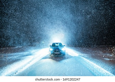 Alta, Norway - Jan 5, 2020: Blue Toyota New Rav4 Hybrid under snowfall in the forest with backlight