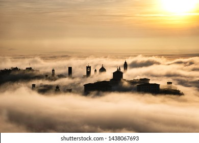 Città Alta, the oldest part of Bergamo, Italy, in a winter foggy morning