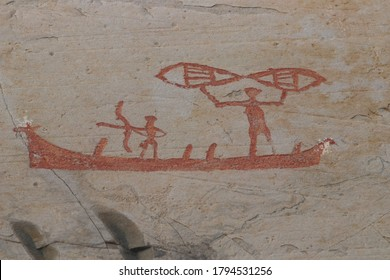 ALTA, TROMS OG FINNMARK COUNTY / NORWAY - AUGUST 03 2020: Rock carvings at Alta. Scenes from the neolithic fishermen life. Carvings were made by the neolithic  and early metal age people