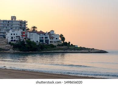 Altafulla, Tarragona, Spain : 2019 Setemeber 08 : Desert beach. View of Altafulla, Tarragona, Spain. Beach in summer on the Sunset.