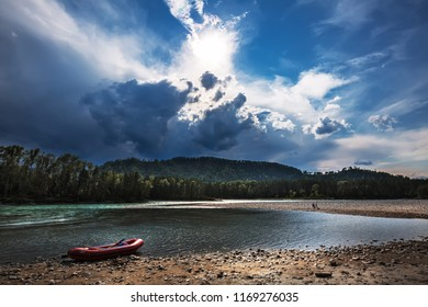 Altai mountains, southern Siberia, Russia-August 25, 2018: Katun mountain river with inflatable rafting vessel