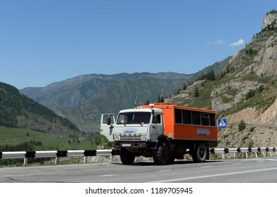 "ALTAI REPUBLIC, RUSSIA JUNE 6, 2018: Tourist car ""Kamaz"" on  the Chuysky tract. Mountain Altai, Siberia, Russia"