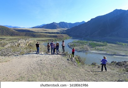 Altai Republic, RUSSIA-MAY 09, 2014: a Tourist group admires the landscape at the confluence of the Siberian mountain rivers Chuya and Katun in the Altai Mountains