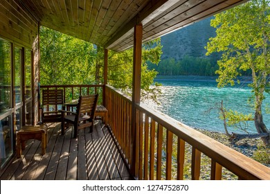 ALTAI REPUBLIC, RUSSIA-September 7, 2018: Veranda wooden guest house of tourist base on the Bank of the Katun river, Argut cluster, Altai Republic, Russia
