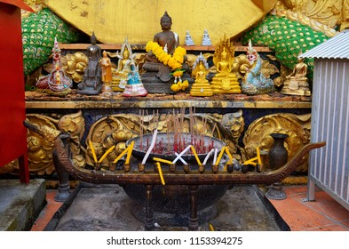 Altar with Buddha figurines at the top of the wat Tham Sua in Krabi