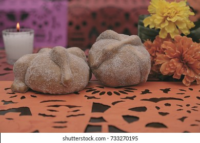 Altar for the day of the dead with bread and flowers