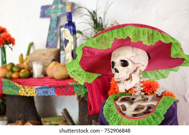 """An altar for the Day of the Dead (Spanish: Día de Muertos) featuring fresh fruit, and """"La Calavera Catrina"""", a dapper skeleton as Lady of the Dead, in Valladolid, Yucatan, Mexico"""