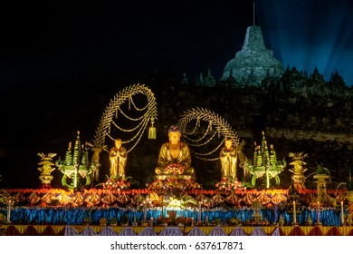 Altar with golden colored buddha-statue and offerings, night / The celebration of the Buddha day, Vesak - Vesakha - Waisak at Borobudur, Indonesia, 2017