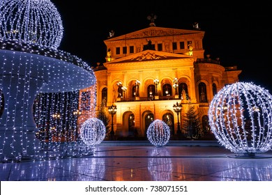 Alte Oper (Old Opera), a concert hall and former opera house in Frankfurt am Main, Germany, with Christmas decorated fountain during winter evening