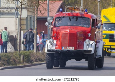 ALTENTREPTOW / GERMANY - MAY 1, 2016: german mercedes benz fire truck oldtimer drives on a street at oldtimer show on may 1, 2016 in altentreptow, germany.