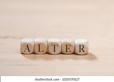 Alter word on wooden cubes. Alter concept
