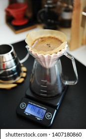 Alternative bunch filter black coffee brew with pink origami dripper. Electronic timer scale. Specialty concept