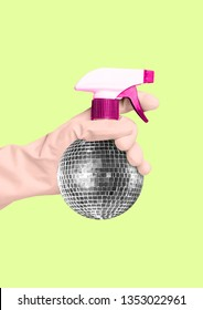 An alternative cleaning - disco spraing bottle. Hand in a housewifely white glove holding spray as a silver discoball against banana colored background. Modern design. Contemporary art collage.