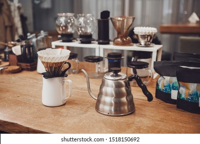 Alternative coffee. Funnel with filter and coffee over the pitcher and metal kettle