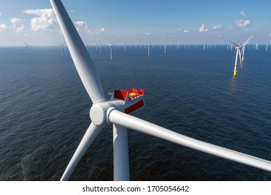 Alternative energy - Aerial view of offshore windmill park at sea