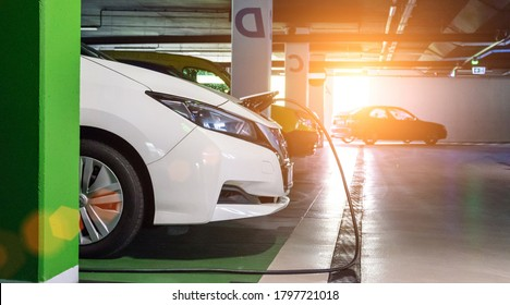 Alternative energy. Electric car charge battery on eco energy charger station. Hybrid vehicle - green technology of future. Eco-friendly alternative energy concept.