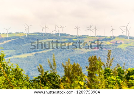 Alternative energy. Electric Power Production. Energy saving wind turbines on a wind farm up on the hills of Manchester, Jamaica.