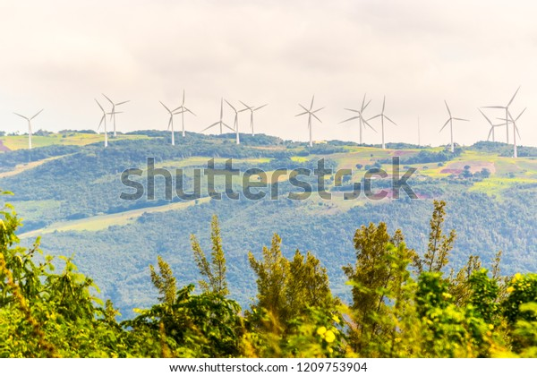 Alternative energy. Electric Power Production. Energy saving wind turbines on a wind farm on the hills.
