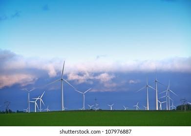 Alternative Energy Landscape - Wind Turbines Farm in Minnesotas Mower County near Dexter, MN. Wind Turbines in Sunset