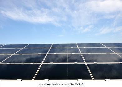 Alternative energy photovoltaic solar panels against blue sky