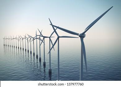 Alternative energy- shot of row of floating wind turbines during foggy morning.