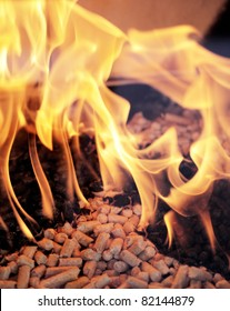 Alternative fuel: Wood pellets burning in a fireplace.