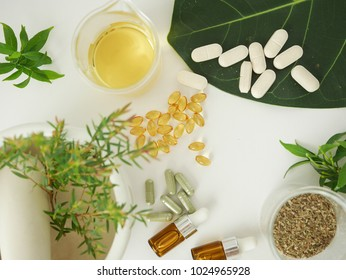alternative herb medicine. herbal vitamin on white background.